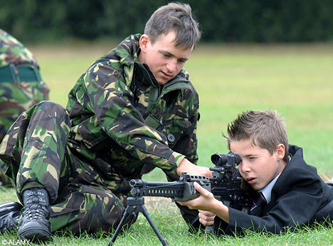 Recruiter instructs child in use of gun